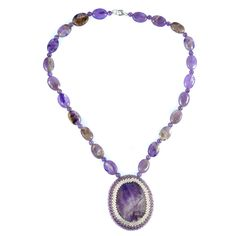 AMETHYST CABOCHON NECKLACE    Dog tooth amethyst and sterling silver necklace (cabochon case hand-sewn with glass beads).    Add romance to your look with this cabochon necklace. Matching items available.  ...  Colour: Purple    Size: 44.5cm    £45.00     http://www.gemjewelleryshop.com/product-information/36/403/amethyst-cabochon-necklace/    See More