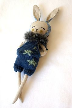 The bunny doll from mini Indigo collection. Joy for the child. The doll is one of a kind, only 1 available! The toy is made of cotton, filler - non-allergenic hollofayber, face - embroidery floss, height 17 inch. All clothing is removable. Can be hand washed in cool water. This Bunny has a history. My son, is three years old, wanted to help me and a little cut up face that I embroidered. I decided to leave it as is because it does not affect the quality.