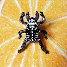 "#skull #beetle #pin likes #oranges :)) 15"" enamel with two rubber clasps. blackbeetle.bigcartel.com Link in bio! by blackbeetlepins"