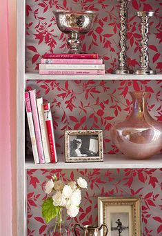Like the metallic wallpaper as background and mixing books with objects: 20 Useful Bookshelf Decorating Ideas on arcilook.com