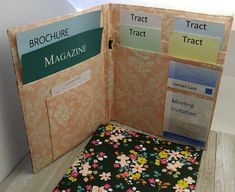 All your literature in one place! • 2 Large pockets for magazines and brochures • 4 pockets for tracts, and clear vinyl pockets for the JW business cards and meeting invitations. • Dark fabric with colorful bunches of flowers. The inside fabric is a light peach. • Built to last with