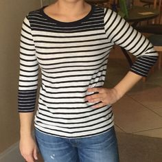 J Crew 3/4 sleeve t-shirt J Crew navy and white stripped 3/4 sleeve t-shirt. Fits really well and accentuates curves really well! Only worn one or two times! J. Crew Tops Tees - Long Sleeve