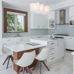 Crisp white kitchen with a touch of timber all blends beautifully. #kitchens