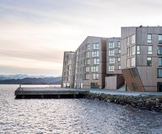 Waterfront project in Stavanger by AART architects | Situated in the city's harbourfront area, the site accommodates 128 freehold flats and a range of communal facilities designed in a style that references Stavanger's heritage of wooden architecture from the 18th and 19th centuries.