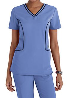 The sporty Dickies Xtreme Stretch Piping Trimmed Scrub Top includes roomy pockets and stretch fabric. Scrubs Uniform, Lab Coats, Nursing Clothes, Scrub Tops, V Neck Tops, Stretch Fabric, Caregiver, Shopping, Women