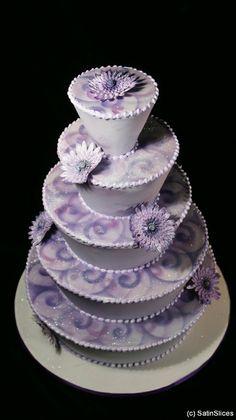 Spectacular purple wedding cake by Satin Slices
