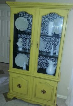 Yellow hutch (distressed, glazed & waxed) with black & white damask back