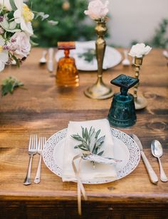i love the vintage colored glassware and the simplicity of this table setting. Fresh herbs are a nice touch.