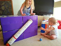 Ball and Tube Play for Babies, Toddlers and Preschoolers - maybe make the top open with sides to hold the balls like a pool table and add more tubes to the sides or other obstacles?