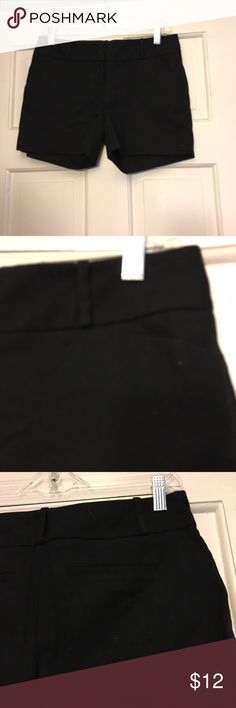 "Black shorts 4"" inseam shorts. Black with small slant pockets in the front. Button and two hook and eye closures in the waist. The Limited Shorts"