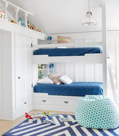 Another blue and white bunk room. Love the chevron carpet and light, airy feel.