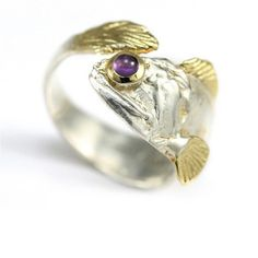 Jewel Fish Ring. Our Jewel Fish Ring features exactly what it says; a fish with a jewel! This unique looking piece will catch everyone's attention; that part is for sure. Featuring a silver plated band with gold plated detailing on both ends, you will be intrigued by everything about this ring.