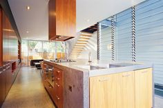 """The only fixed element on the ground floor is the concrete kitchen bench, which places the """"hearth"""" of the home at the heart of the action."""