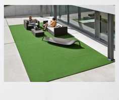 Very simple and minimalistic use of artificial grass - striking. Like it.