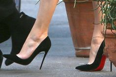 Closeup of the Christian Louboutin So Kate pumps in black suede on Jennifer Lopez