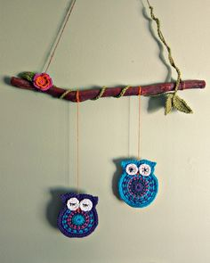 My purple & blue crochet owls, made for The Bower Bird Project (Long Jetty NSW) I love winding the 'vine' around the branch, and the combination of bright cotton, with natural twine to hang and a branch found in my garden. A simple whimsical and fun hanging decoration for a child or nursery - gorgeous !