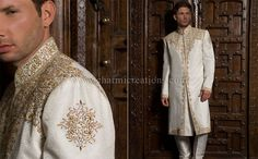 Ivory Suit: Ivory brocade silk wedding sherwani with chains of diamante and gold jarosi work.