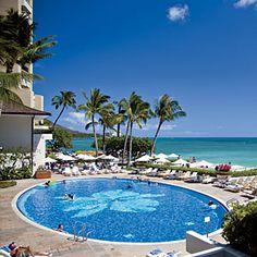 Halekulani Hotel - Honolulu, HI  A beautiful place to watch the sunset.