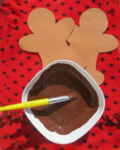 Paint gingerbread men with scented paint! Just mix cinnamon and brown paint! (I'd add some ginger and ground cloves too.)