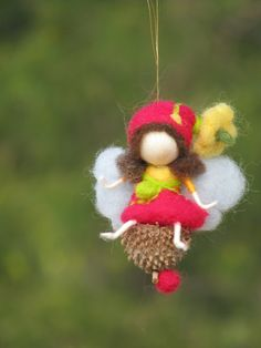 Needle felted  fairy swings on a seed by Made4uByMagic on Etsy, $24.00