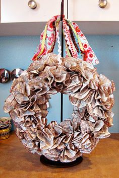 A wreath? Out of book pages? I'm in love. And not just with destroying literature. But, sure, that plays a part. (Book Wreath by Snowy Bliss)
