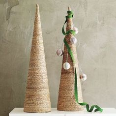 DIY twine wrapped christmas trees. Could probably make this cheaper by making the cones from card stock.