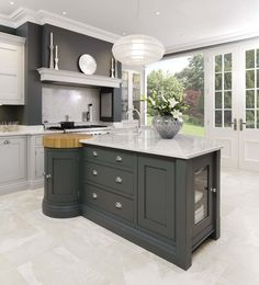 This sleek painted kitchen is a contemporary twist on a traditional shaker style featuring bespoke cabinetry and dark oak kitchen dresser.