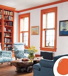 White trim and colored walls may be traditional, but here's a case for flip-flopping the formula. To finish this loft-like living space in an 1861 Brooklyn rowhouse, designer Rafe Churchill trimmed the walls and windows with orange, framing the room as well as the view, and bathed the built-in bookcases with the same hue, bringing out the warm patina of the original heart-pine floor.