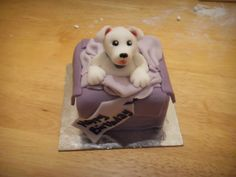 Dog in a box mini cake tutorial http://cakespriteprojects.wordpress.com/2014/03/25/who-let-the-dog-out-dog-in-a-parcel-mini-cake-tutorial/
