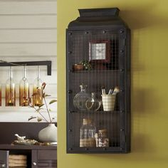 Rustic Wall Cabinet from Country Door. Ultra-chic, industrial style metal cabinet with wire front and sides has 3 fixed shelves and a hinged door.