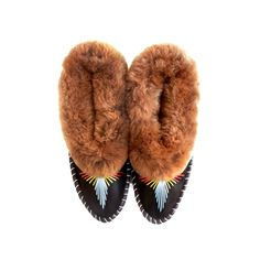 Our slippers are handcrafted by artisans in Poland. The design is inspired  by traditional Polish house shoes that have been inherent to the region for  generations. Each pair of slippers features a plush shearling cuff, silk  string, and leather sole/ trim. The cozy interior hugs the foot with  moisture-wicking sheepskin for both breathability and warmth. Slight  variations are what make our slippers so special and unique.      * Stringing:  Ice Blue, Gold, Red      * Handmade; Genuine ...