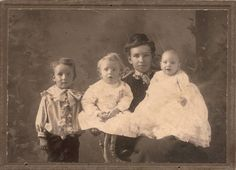 My Grandmother Hart with her first three sons, taken about 1905 when all babies wore dresses, including boys. My father is the one in the middle.