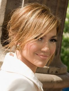 Jennifer Lopez Hairstyles: Sunny Messy Updo with Side-swept Bangs ...