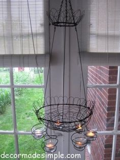 wire clothes hanger chandelier. I have so many hangers. Now I know what to do.
