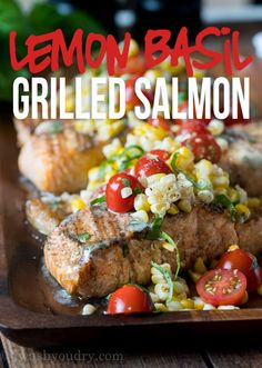 This Lemon Basil Grilled Salmon is topped with a lemon and basil infused butter and a grilled corn and tomato salad that's so fresh and delicious! #sponsored @landolakes
