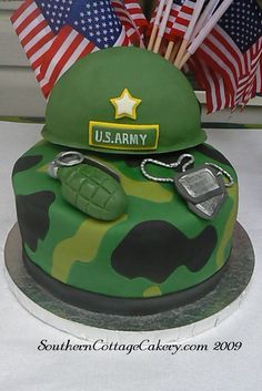 Army Cake - This is a cake I made for my sons 7th birthday! I used fondant to cover it and made the grenade and dogg tags, etc. out of fondant. The hat is styrofoam covered in fondant. I have pics of the party and a few more details on my Blog!