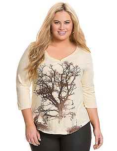 Bronze foil print adds an extra-special touch to our tree graphic tee. Flattering V-neckline with raw edge trim and 3/4 sleeves. lanebryant.com