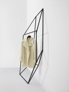 Les Ailes Noires is a collection of clothing racks inspired by the simplicity of geometric line drawings. The collection contains 11 different freestanding units that are weighted to lean against a wall or flat surface. Tong found it interesting that a simple two-dimensional line drawing can communicate three-dimensions, and experimented with these shapes to create various volumetric perceptions.