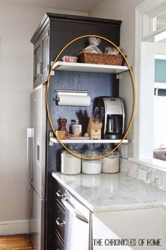 The side of cabinet would be the perfect spot for floating shelves
