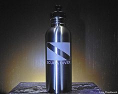 This etched brushed stainless steel bottle is for you, or for the scuba divemaster in your life that has everything. You are looking at ONE etched stainless steel bottle. It has a Scuba Dive Flag and Stainless Steel Water Bottle, Brushed Stainless Steel, Scuba Shop, Etched Gifts, Gifts For Scuba Divers, Dive Flag, Slumped Glass, Glass Beer Mugs, Green Copper