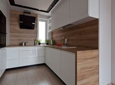 Kitchen worktop, laminated wood credenza and white cabinets without handles