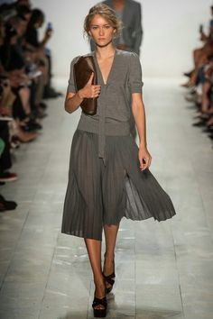 NYFW Michael Kors Spring Summer 2014 Fashion Show louboutins and love fashion blog celebrity inspiration beautiful model runway sandals bag makeup beauty hair floral belt collar vest trench coat bikini dress skirt shirt grey pleats business casual