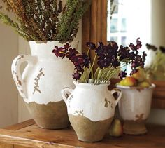Assorted sizes and shapes rustic Tuscan inspired pottery via The Pottery Barn
