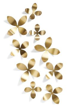 $30 Free shipping and returns on UMBRA 'Wallflower' Wall Art at Nordstrom.com. Intensify the minimalist sophistication of any space with a collection of brushed metallic flowers that can be arranged in a multitude of freeform configurations.