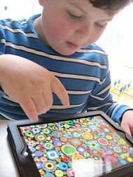 Finding Good Apps for Children with Autism -- NYTimes 2011    Leo Rosa, son of Shannon Des Roches Rosa, of Redwood City, Calif., plays with Spot the Dot, an educational app for the iPad that has been shown to work well with children who have autism.