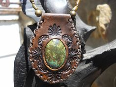 Leather pendant set turquoise. Strung with turquoise, tigers eye, moss agate and brass beads with brass fob clasp. R620. BP2. This item has been sold, but if you like it and want something similar, let us know! www.feeko.co.za