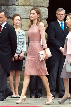 The queen has a respectful moment in pale pink while attending a ceremony in remembrance of the victims of a train accident.   - HarpersBAZAAR.com
