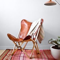 "Daily Find: Palermo Tripolina Chair - From the brand new online store, Citizenry, this is their Palermo chair made of super thick 100% Argentinian polo saddle leather. The supporting frame is hand-carved from high quality guindo wood, a lightweight but incredibly durable timber, and the entire thing folds up in an instant. Limited edition only. Their further explanation: ""This 'Tripolina' style was originally designed in 1855 by a British engineer; it was widely known in Europe as a military…"