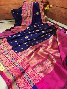 Create a smashing impact on anyone by wearing this luxurious Navy Blue color Silk Mark Katan Banarasi Saree. You can see some intriguing patterns on the Hot Pink color double border and pallu. Buy pure Banarasi Silk saree online & make a spotting and iconic look like never before.