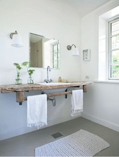 Simple reclaimed wood bathroom counter.